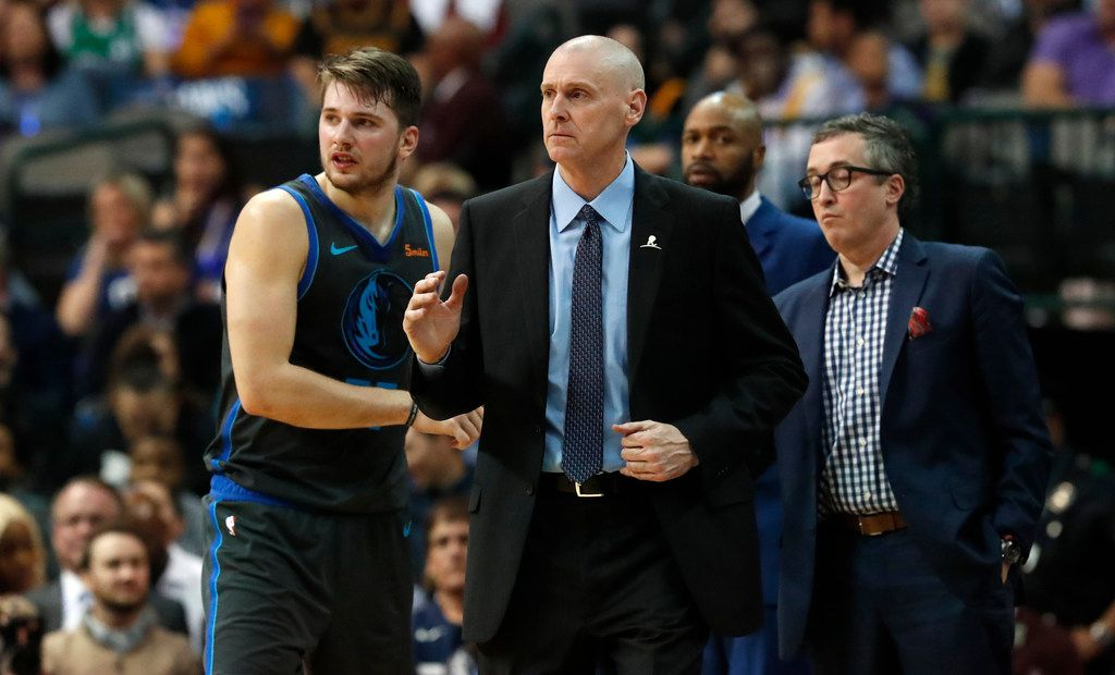 Dallas Mavericks head coach Rick Carlisle, center, looks on with forward Luka Doncic (77) during the second half of an NBA basketball game against the Los Angeles Lakers in Dallas, Monday, Jan. 7, 2019. (AP Photo/LM Otero)