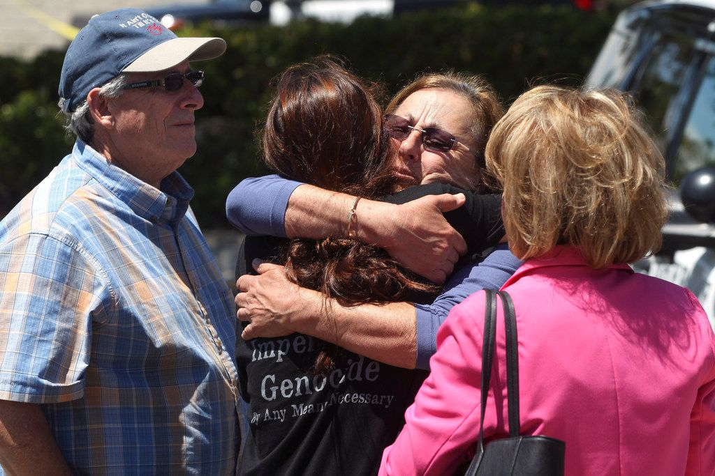 Members of the Chabad synagogue hug as they gather near the Altman Family Chabad Community Center, Saturday, April 27, 2019 in Poway, Calif. A shooting at a synagogue outside San Diego where worshippers were celebrating the last day of Passover sent multiple people to the hospital Saturday.