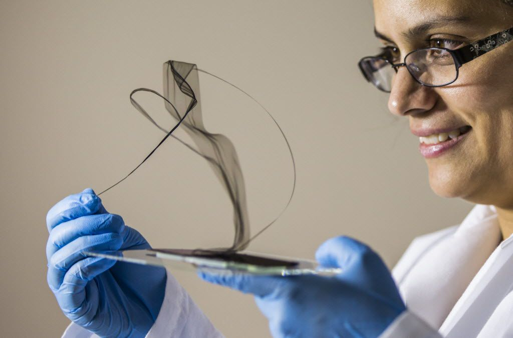Raquel Ovalle Robles, manager of research and intellectual property at the Lintec of America, Inc. Nano-Science & Technology Center demonstrates the dry draw of aerogel sheets from an array of carbon nanotubes at the center in Richardson on Saturday, Jan. 24, 2015. (Smiley N. Pool/The Dallas Morning News)