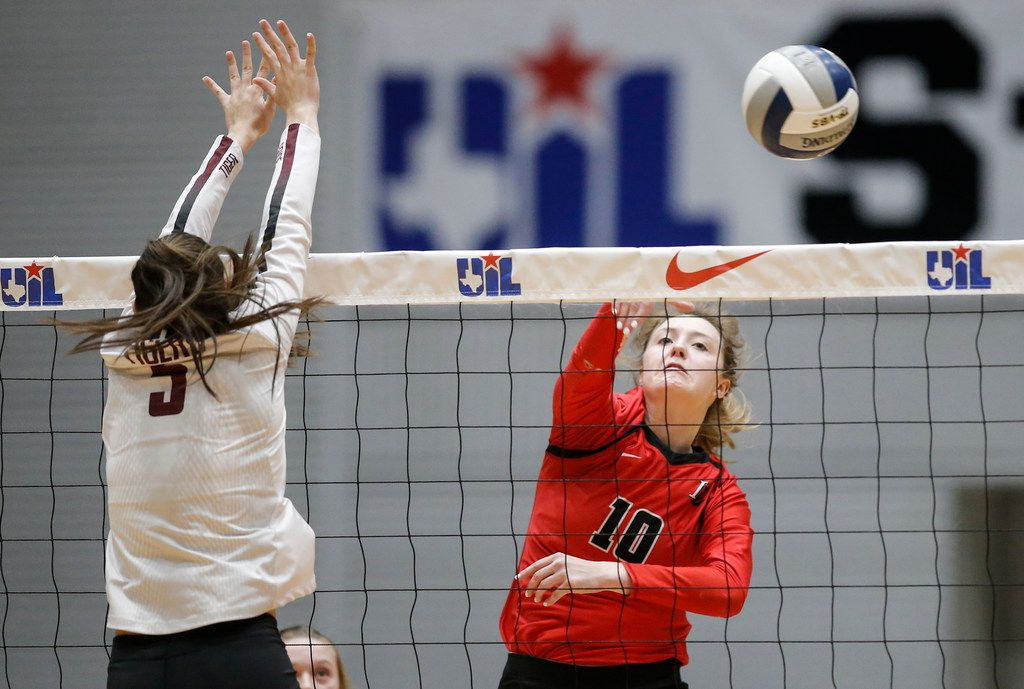 LoveJoy's  Madison Waters (10) spikes the ball as Dripping Springs' Danielle Lebovitz defends during Lovejoy's three-set win in Friday's Class 5A state semifinal at the Curtis Culwell Center in Garland. (Brandon Wade/Special Contributor)