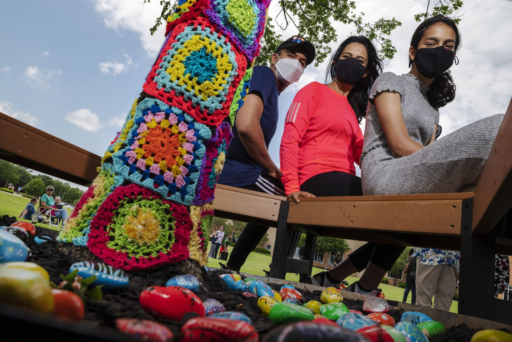 Anya Ali (right) sits with her mother, Anjum Gilani, and father, Ameen Ali, at her Girl Scout project.