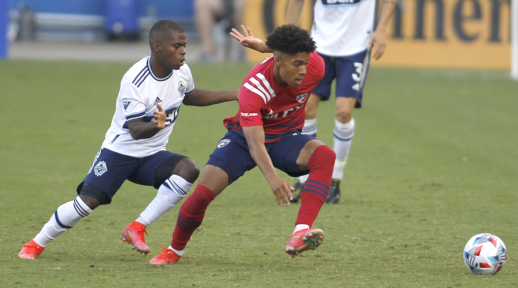 FC Dallas defender Justin Che (32), right, cuts toward the ball as Vancouver midfielder Deiber Caicedo (7) moves in during first half action. The two Major League Soccer teams played their match at Toyota Stadium in Frisco on July 4, 2021. (Steve Hamm/ Special Contributor)