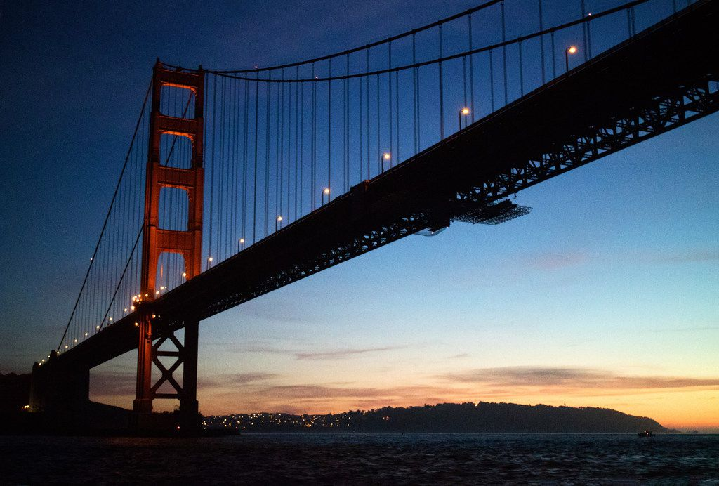 The sun sets behind the Golden Gate Bridge on the expedition's return trip into San Francisco Bay.