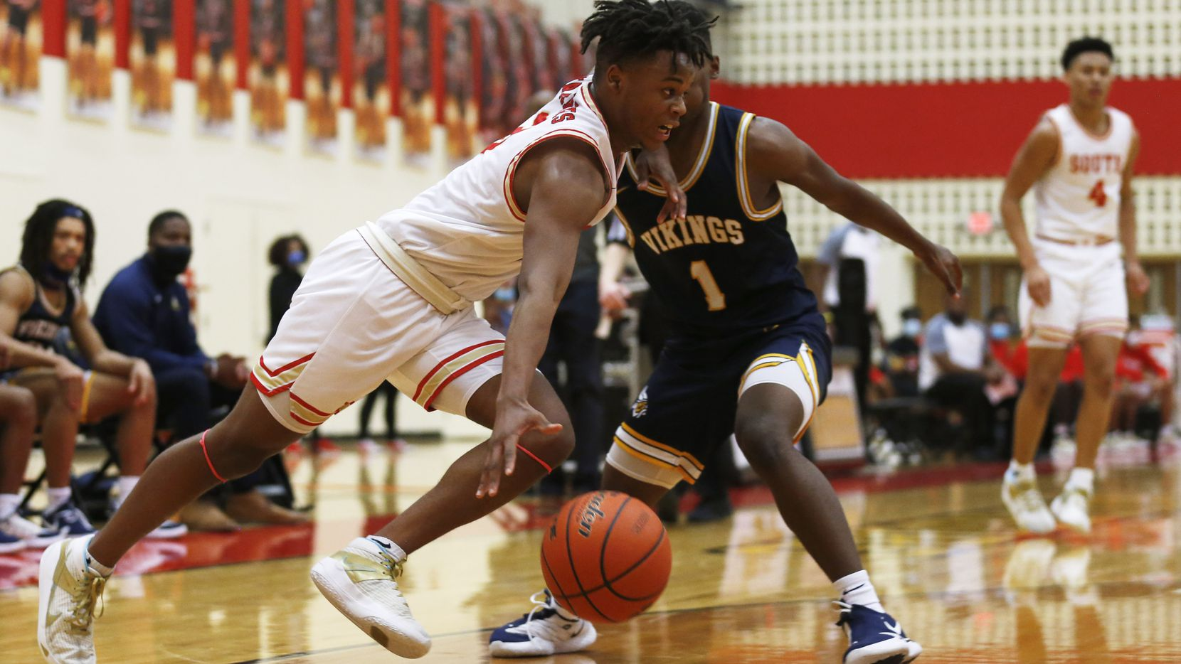 South Grand Prairie's Anthony Solomon (3) drives past  Arlington Lamar's Jalen Ware-Williams (1) during the first quarter of play at South Grand Prairie High School on Tuesday, January 19, 2021in Grand Prairie, Texas.