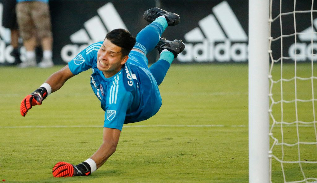 FC Dallas goalkeeper Jesse Gonzalez (1) dives to try a block a shot during the FC Dallas vs. the Chicago Fire major league soccer game at Toyota Stadium in Frisco, Texas on Saturday, July 14, 2018. (Louis DeLuca/The Dallas Morning News)