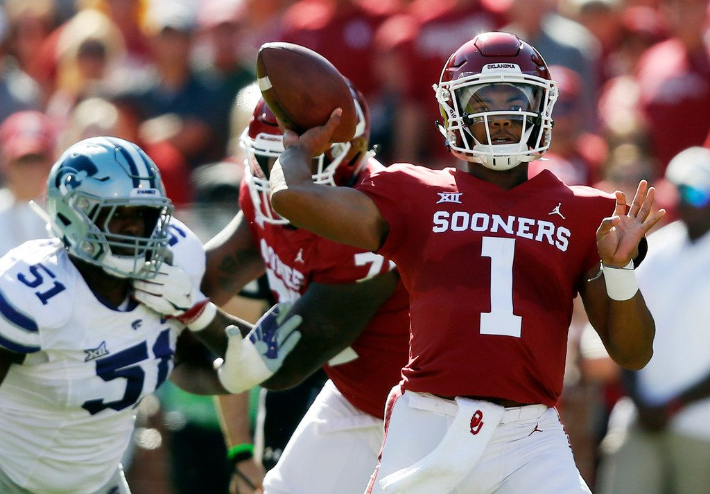 FILE - In this Oct. 27, 2018, file photo, Oklahoma quarterback Kyler Murray (1) throws in front of Kansas State defensive end Reggie Walker (51) in the first half of an NCAA college football game in Norman, Okla. Murray trusts Oklahoma coach Lincoln Riley's Air Raid system and the players in it. (AP Photo/Sue Ogrocki, File)