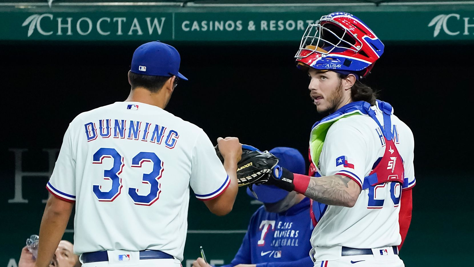 Texas Rangers pitcher Dane Dunning gets a fist bump from catcher Jonah Heim after pitching the sixth inning against the Baltimore Orioles at Globe Life Field on Saturday, April 17, 2021.