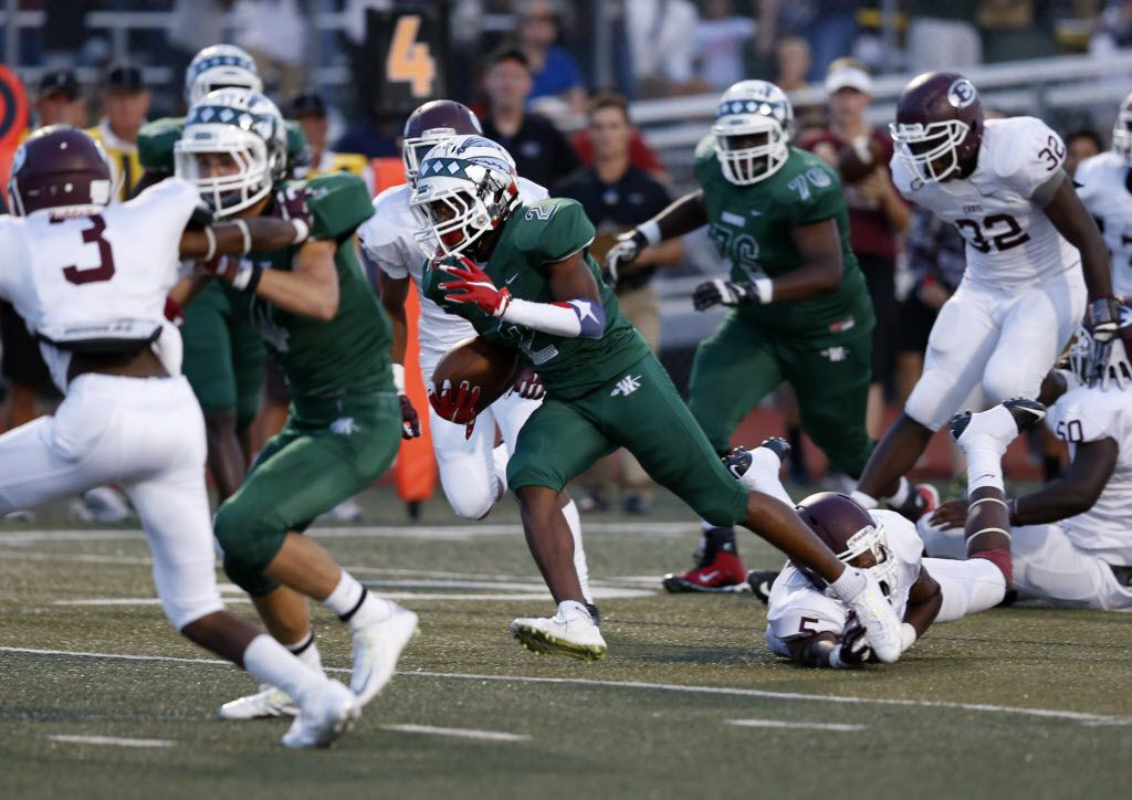 Waxahachie receiver Kenedy Snell (2) finds a hole past the Ennis defense in the first quarter of the game between Waxahachie High School and Ennis High School at Lumpkins Stadium in Waxahachie, Texas on Sept. 11, 2015.