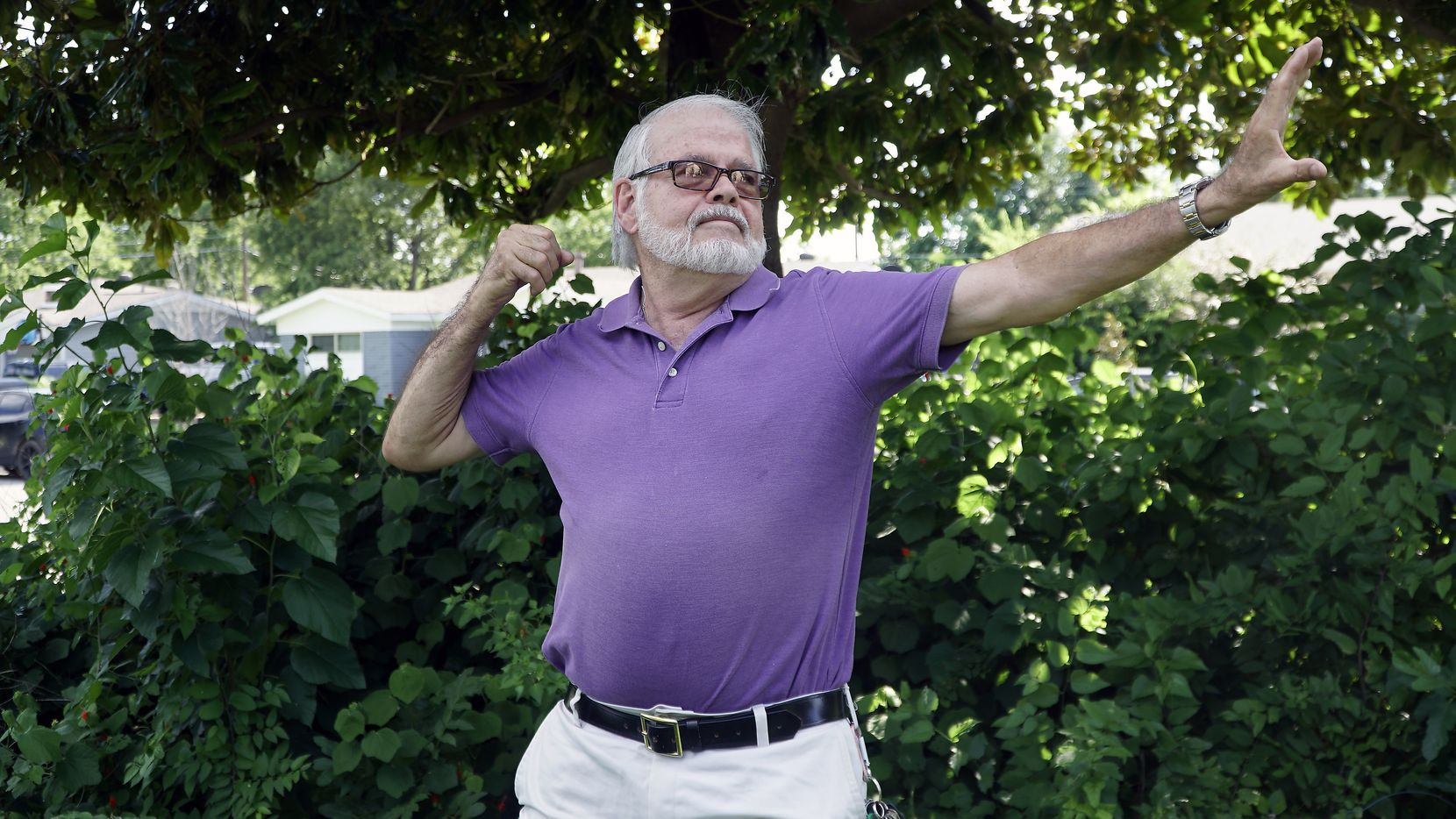 Richard Giltner practices qi gong outside his Fort Worth home. He credits the meditative exercise with reducing the stress of caring for his wife, a cancer patient.