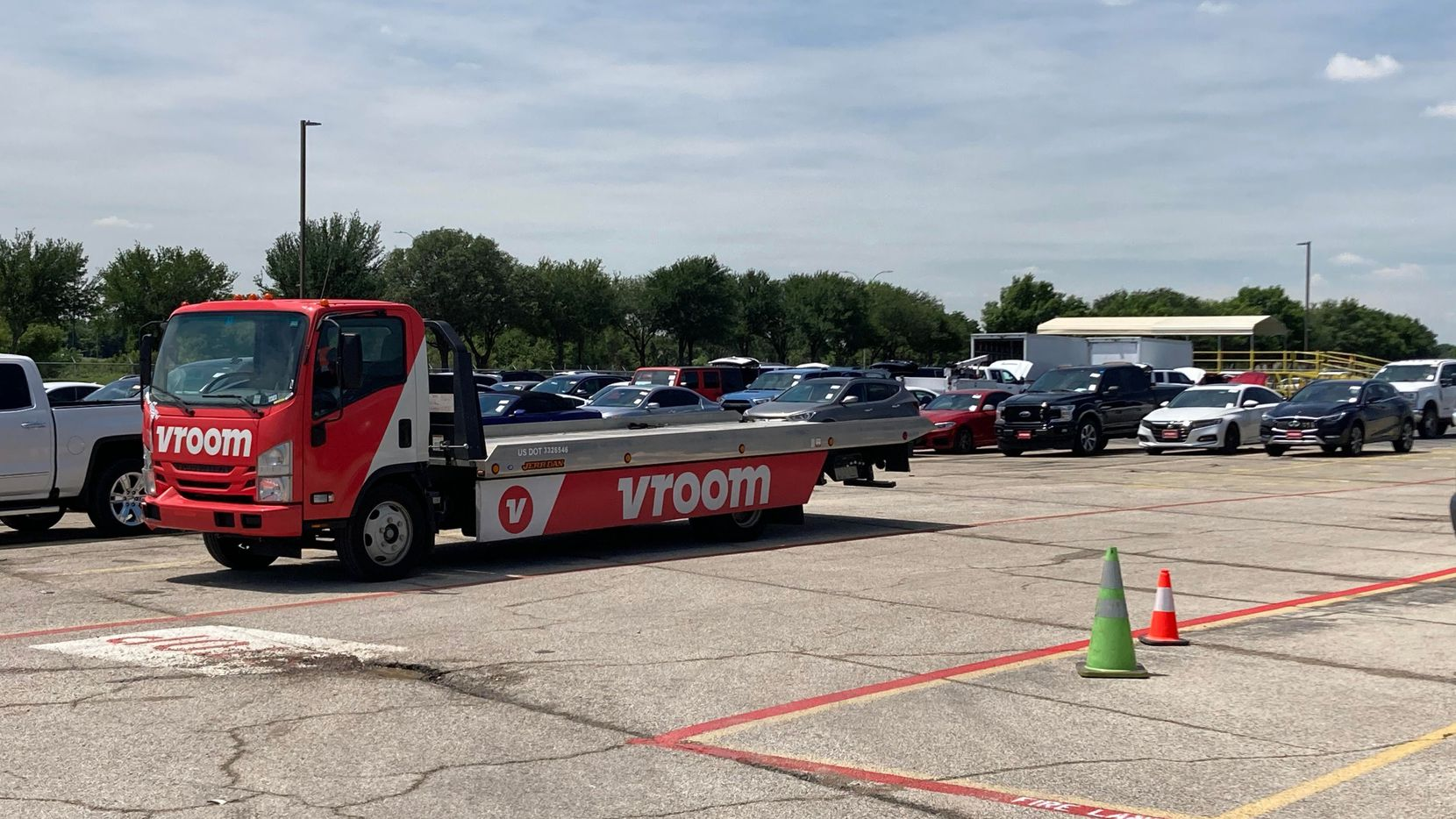 Vroom's new last-mile concierge facility in Euless will allow the company to send a representative to customers' driveways to help answer questions about and navigate their new vehicles.