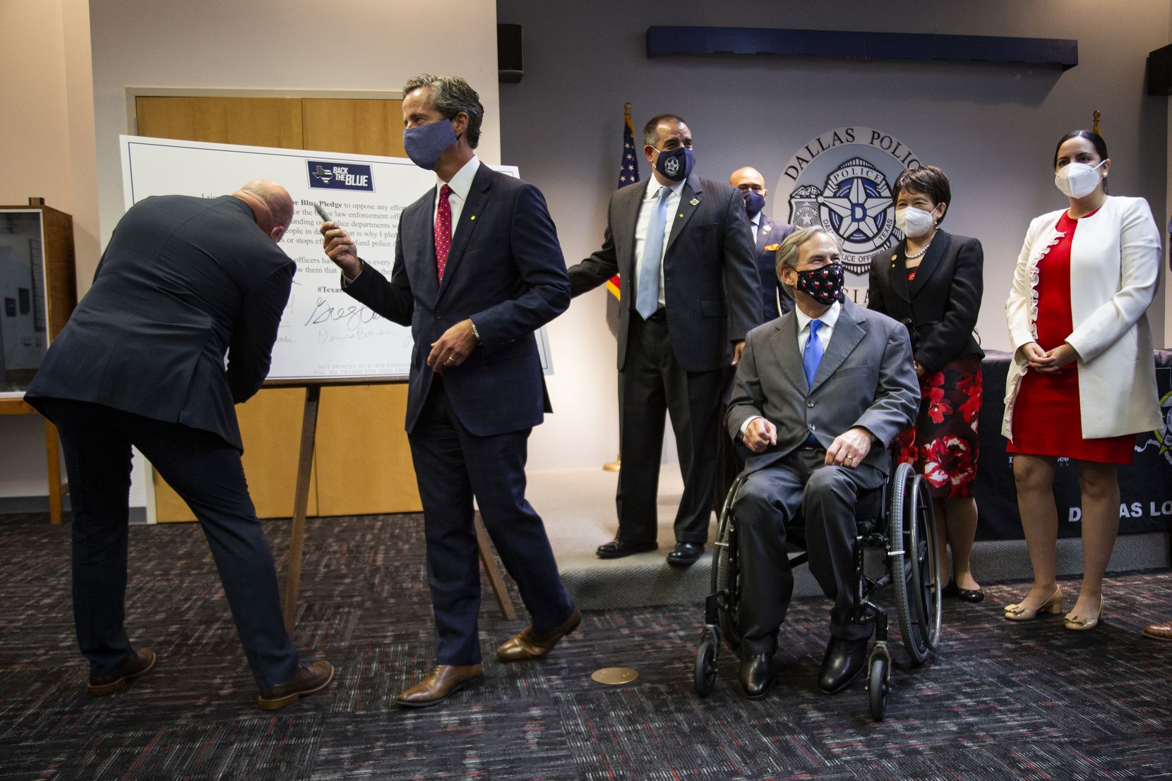 Governor Greg Abbott waits as local elected officials sign a Back the Blue Pledge after a press conference to announce legislative proposals related to public safety at the Dallas Police Association in Dallas Sept. Thursday, 24, 2020 . (Juan Figueroa/ The Dallas Morning News)