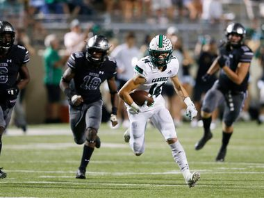 Southlake Carroll's Brady Boyd (14) runs up the field after making a catch against Denton Guyer on October 4, 2019. (Vernon Bryant/The Dallas Morning News)