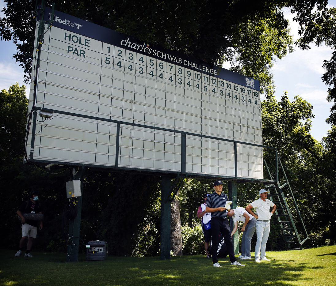 PGA Tour golfers Jordan Spieth (left) and Rickie Fowler takes relief from the sun before an empty leader board during the second round of the Charles Schwab Challenge at the Colonial Country Club in Fort Worth, Friday, June 12, 2020. The Challenge is the first tour event since the COVID-19 pandemic began. (Tom Fox/The Dallas Morning News)