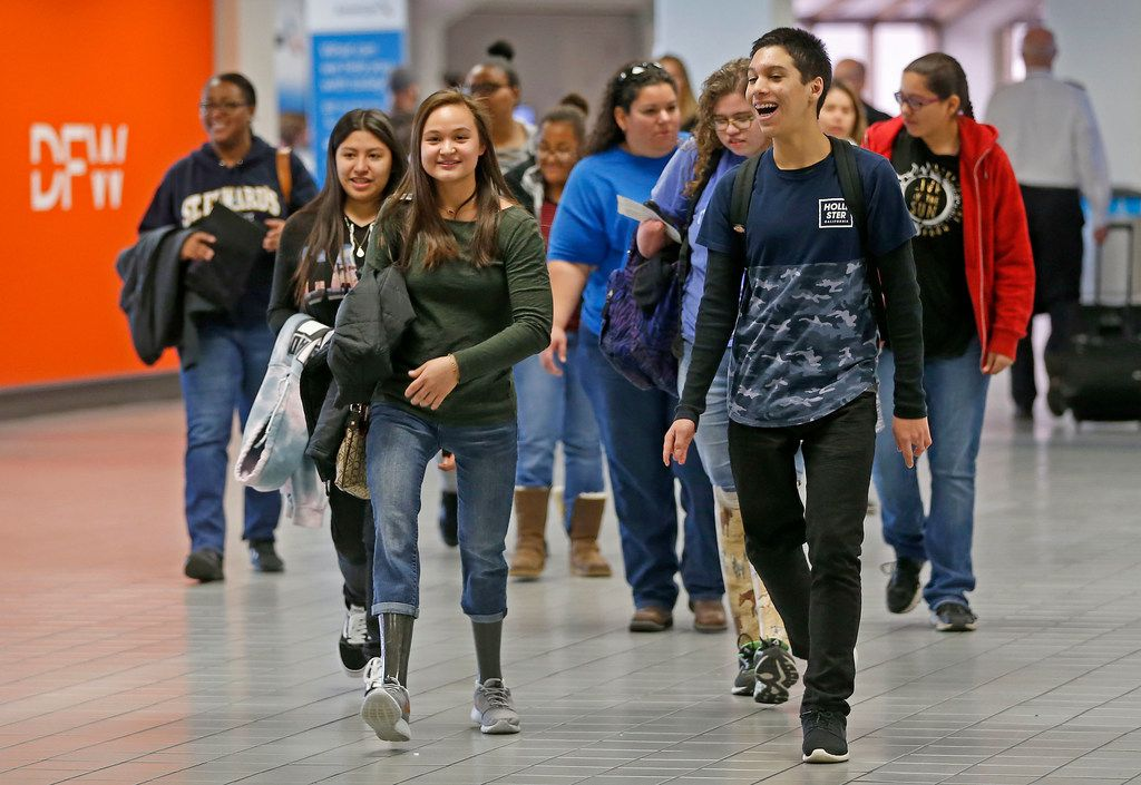 A group of 14 teenage amputee patients from Scottish Rite Hospital, parents, medical staff and chaperones arrive at Terminal C at D-FW International Airport, Monday, Feb. 12, 2018. (Jae S. Lee/The Dallas Morning News)
