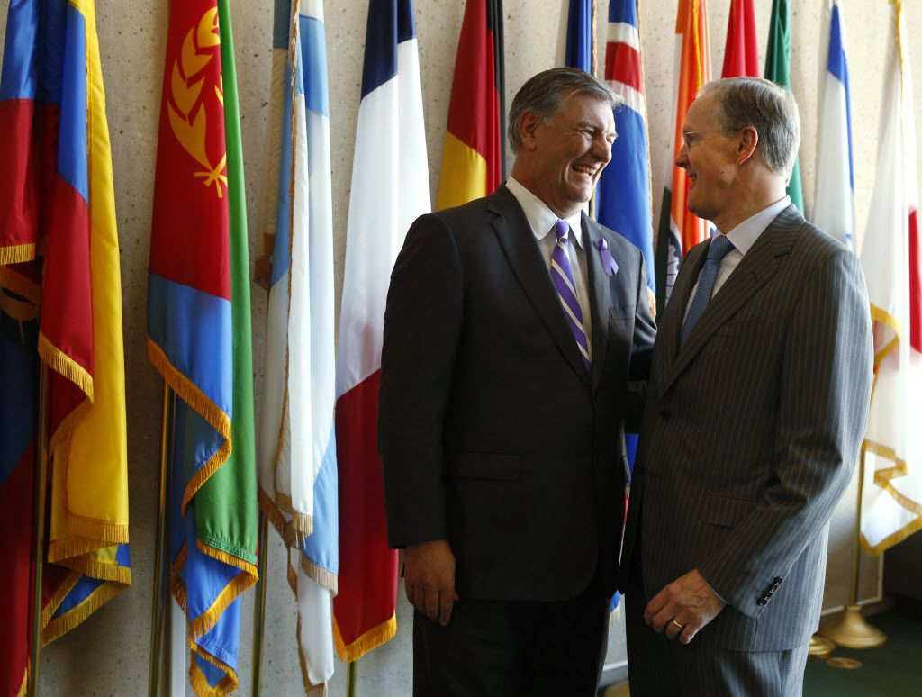 Robert W. Decherd (right), with Dallas Mayor Mike Rawlings, heads the foundation that is offering to build the park at Pacific Plaza at no cost to the city. (2015 File Photo/Nathan Hunsinger)