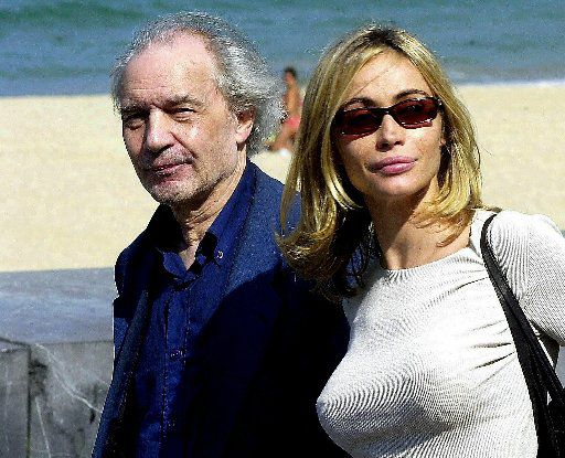 French actress Emmanuelle Beart and film director Jacques Rivette pose for the photographers at the San Sebastian International Film Festival in 2003.