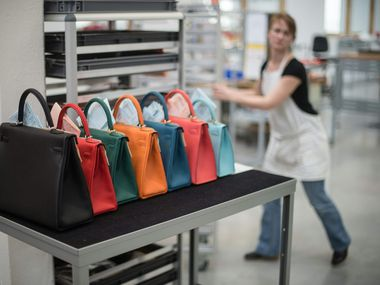 In this file photo taken in 201,6 a woman works in the Hermes workshop on the eve of the inauguration day, in Hericourt, eastern France.