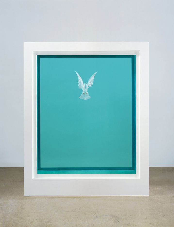 This undated photo provided by Christie's Images shows The Incomplete Truth, a piece of art by Damien Hirst, presenting a dove in formaldehyde solution contained within glass, painted aluminum, silicone, acrylic and stainless steel. The item is one of more than 200 art pieces from music artist George Michael's private collection that will go up on the auction block in London in March.