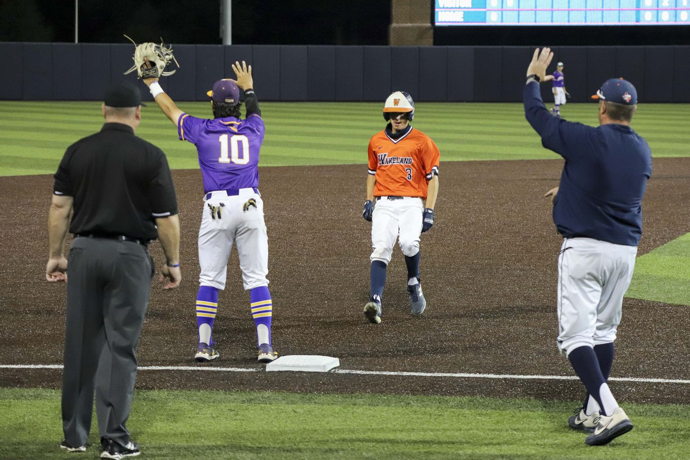 Frisco Wakeland designated hitter Luke Robertson (3) reaches third base after a sacrifice fly during game two of the UIL baseball 5A Region II final series against Hallsville at Horner Ballpark in Dallas on Friday, June 4, 2021. (Elias Valverde II / Special Contributor)