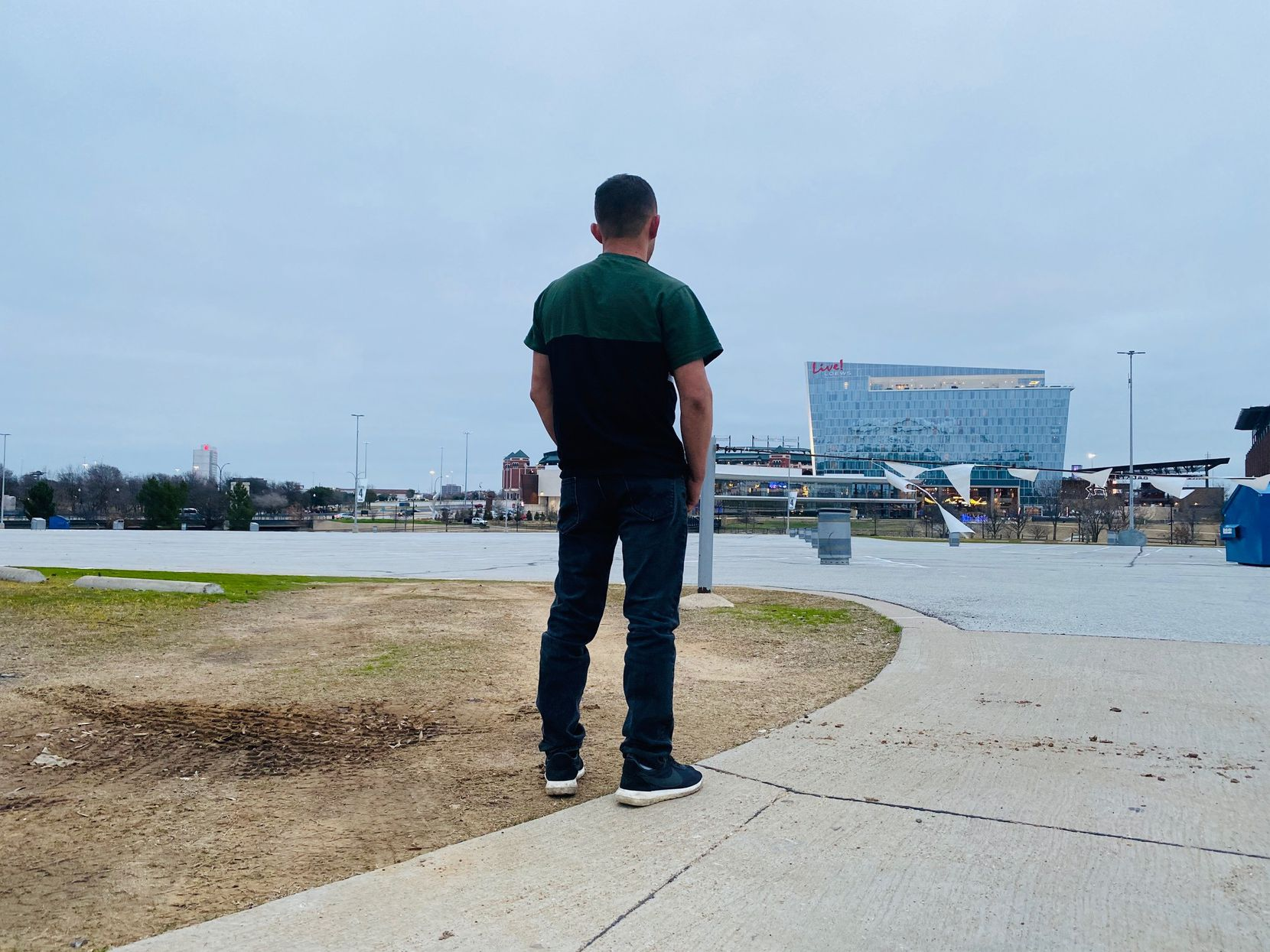Carlos Joaquin Salinas works in North Texas as he waits for his hearing to make his asylum case before the U.S. government