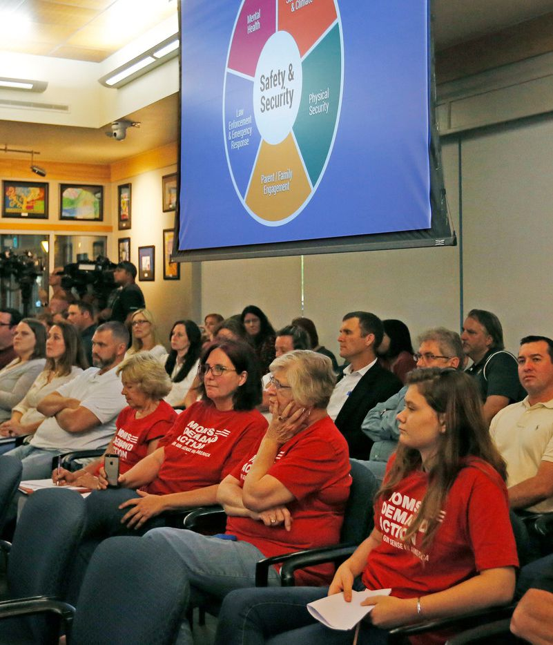 Concerned citizens listen as McKinney ISD spokesman Cody Cunningham talks with the school board about school safety in the district during a meeting Tuesday at the McKinney ISD administration building.