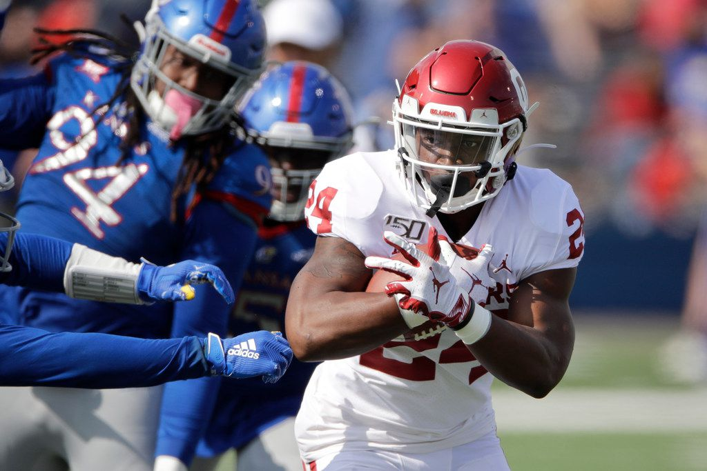 Oklahoma running back Marcus Major (24) runs the ball during the second half of an NCAA college football game against Kansas Saturday, Oct. 5, 2019, in Lawrence, Kan. (AP Photo/Charlie Riedel)