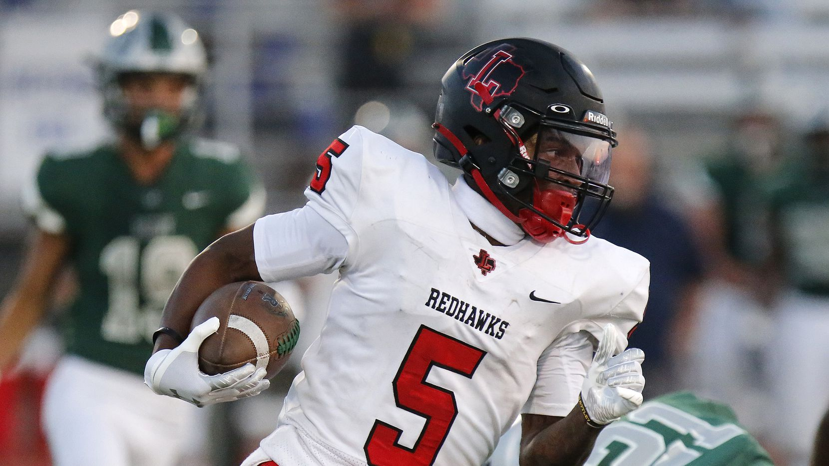 Frisco Liberty wide receiver Evan Stewart carries the football during a game against Frisco Reedy on August 26, 2021. (Stewart F. House/Special Contributor)
