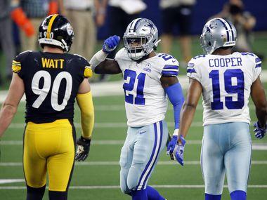 Dallas Cowboys running back Ezekiel Elliott (21) celebrates picking up the first down Pittsburgh Steelers outside linebacker T.J. Watt (90) during the third quarter at AT&T Stadium in Arlington, Texas Sunday, November 8, 2020.