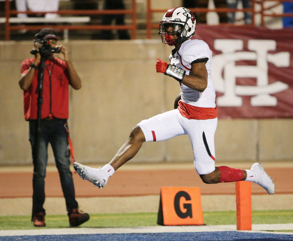Cedar Hill receiver Josh Fleeks (1) runs for a touchdown after catching the ball to make the score 53-50 in the fourth quarter during a high school football game between Cedar Hill and Duncanville at Panther Stadium in Duncanville, Texas Friday September 30, 2016. Cedar Hill beat Duncanville  54-50. (Andy Jacobsohn/The Dallas Morning News)