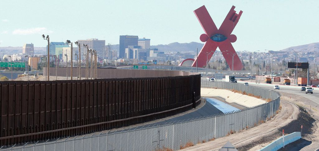 Traffic moves on the El Paso border highway, right, next to the border fence the separates the U.S. and Mexico.  (Victor Calzada/The El Paso Times via AP)