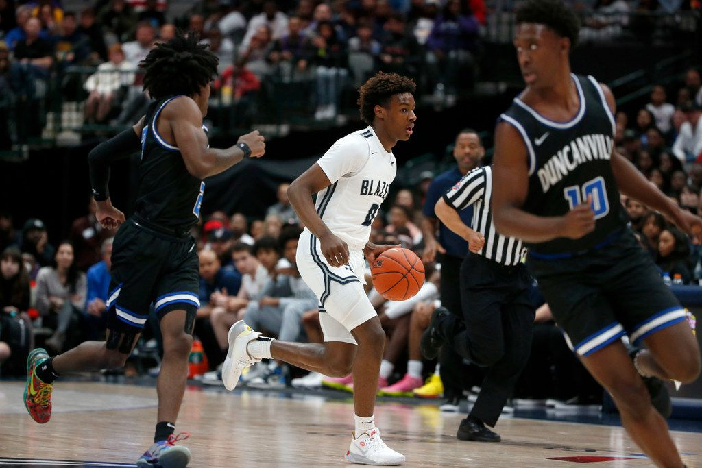 Sierra Canyon's  Bronny James ()) dribbles against Duncanville during their high school boys basketball game during the Thanksgiving Hoopfest in Dallas, Tx, Saturday, Nov. 30, 2019. (Michael Ainsworth)