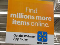 Signs informing customers about Walmart's online shopping at the Walmart Supercenter at Timber Creek Crossing in Dallas.