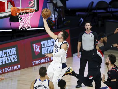 Dallas Mavericks guard Luka Doncic (77) shoots against the Portland Trail Blazers during the second half of an NBA basketball game Tuesday, Aug. 11, 2020, in Lake Buena Vista, Fla. (Kim Klement/Pool Photo via AP)