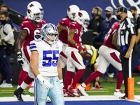 Dallas Cowboys outside linebacker Leighton Vander Esch (55) walks away as against the Arizona Cardinals players celebrate a touchdown by wide receiver Christian Kirk (13) during the second quarter of an NFL football game at AT&T Stadium on Monday, Oct. 19, 2020, in Arlington.