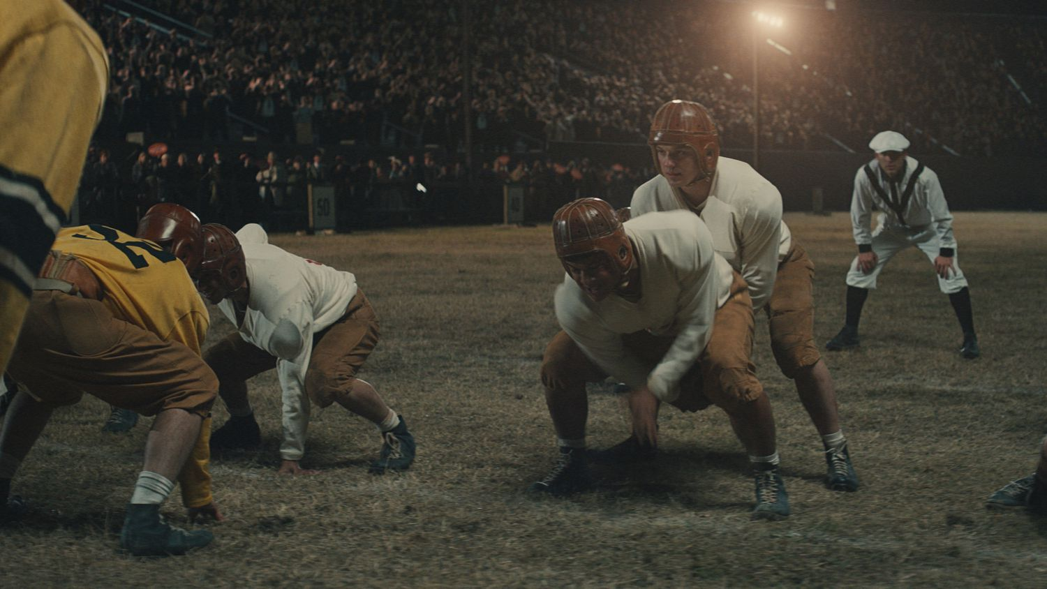"""The Mighty Mites line up on offense against the Amarillo Sandies in a scene from the forthcoming movie about Texas high school football titled """"12 Mighty Orphans."""""""