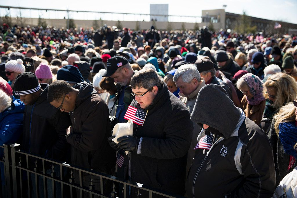 """Thousands pray during a speech by the Rev. Franklin Graham, the son of Rev. Bill Graham, as part of his """"Decision America Tour"""" in Atlanta, Feb. 10, 2016. Evangelicals like Graham are locked in a tight embrace with the president and the Republican Party, but some are now asking if the movement has gone astray."""