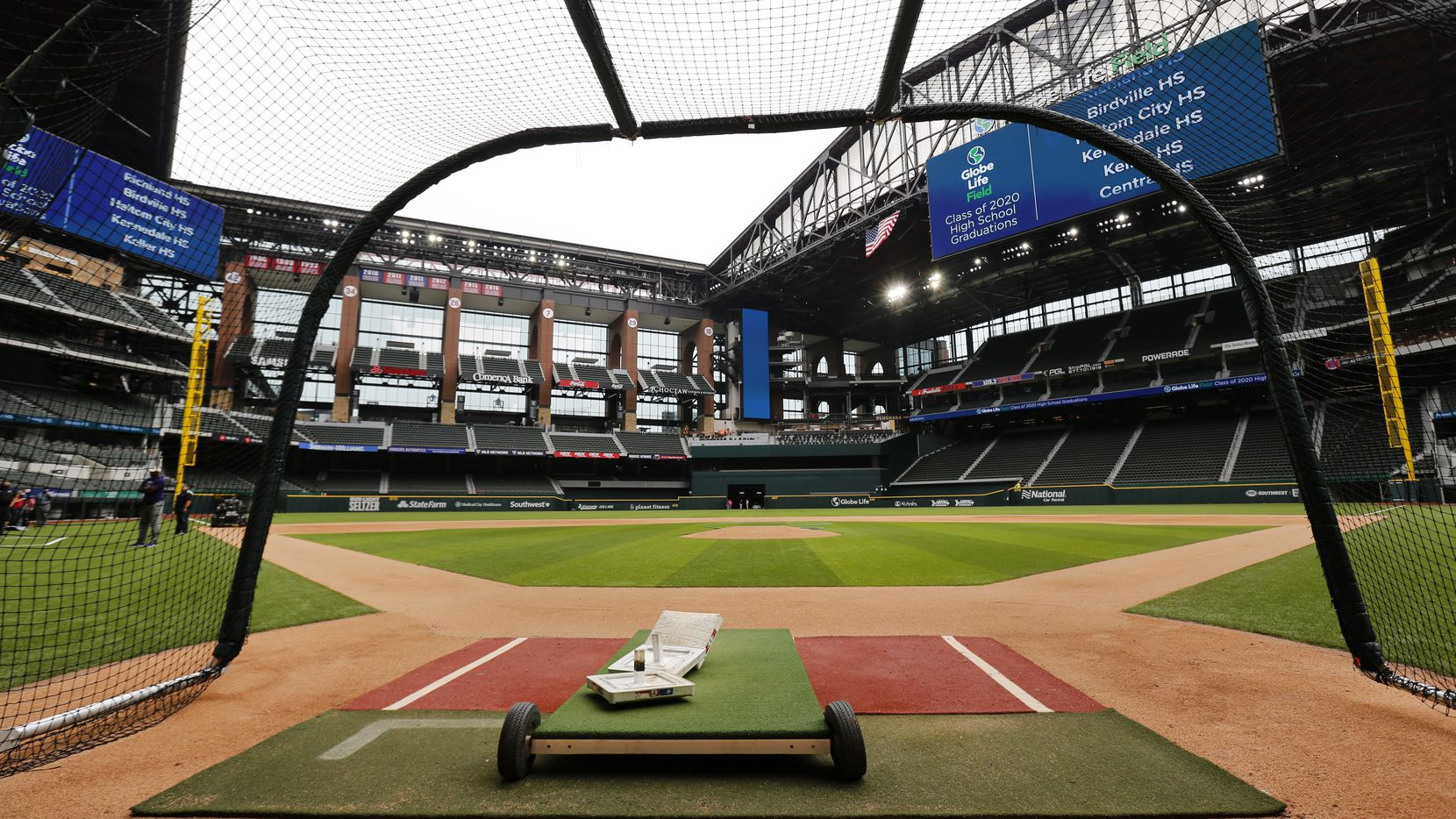 Texas Rangers players have been using a batting cage on the field of the newly completed Globe Life Field in Arlington, Texas, (Tom Fox/The Dallas Morning News)