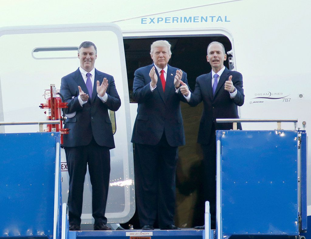 President Donald Trump stands by a Boeing 787-10 Dreamliner, with Boeing executive Kevin McAllister, left, and CEO Dennis Muilenburg, in the final assembly building at Boeing South Carolina in North Charleston, S.C., Friday, Feb. 17, 2017. The president visited the plant where Boeing rolled out the first 787-10 Dreamliner aircraft from its assembly line. (AP Photo/Mic Smith)