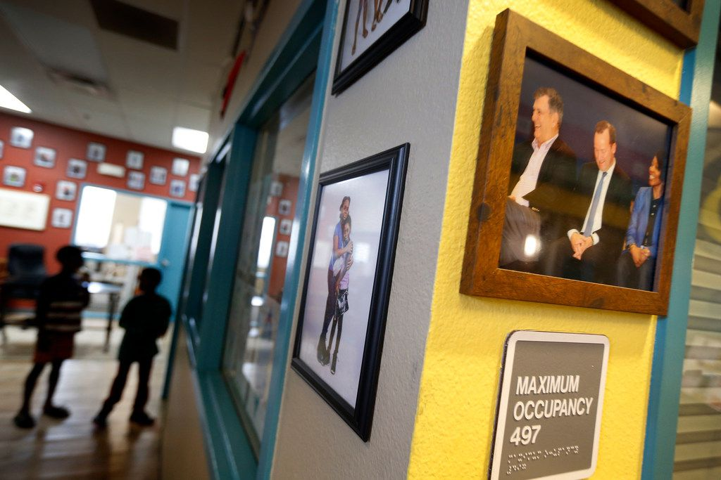 A photo of Brandoniya Bennett, 9, hangs around the corner from a photo of former Dallas Mayor Mike Rawlings, former Dallas councilman Philip Kingston and Dallas Police Chief U. Renee Hall taken in October 2017.