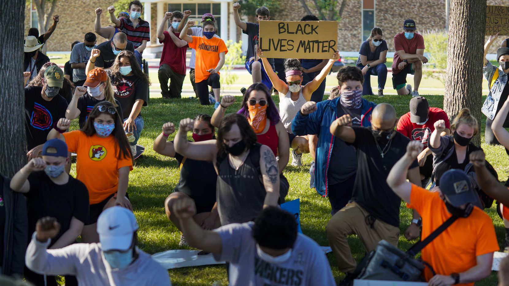 Demonstrators take a knee for 8 minutes and 46 seconds during a protest organized by Berkner High School students at Berner Park as protests continue after the death of George Floyd on Wednesday, June 3, 2020, in Richardson.