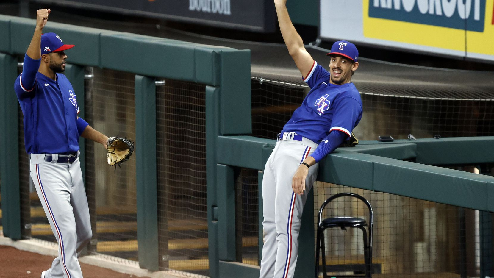 Texas Rangers first baseman Ronald Guzman reacts after snaring a fly ball over the photo well railing during a simulated game at Summer Camp inside Globe Life Field in Arlington, Texas, Thursday, July 9, 2020. (Tom Fox/The Dallas Morning News)