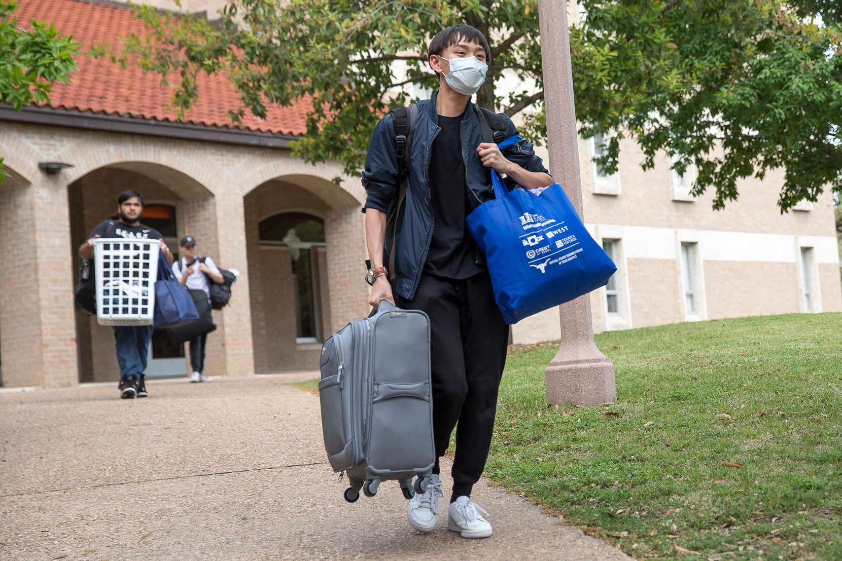 Chris Hsu, 19, a freshman at the University of Texas, moves out of Jester dormitory for a two week spring break on March 13, 2020. The University cancelled classes on Friday, March 13th and students are advised the break may be extended past two weeks. (Julia Robinson/Special Contributor)