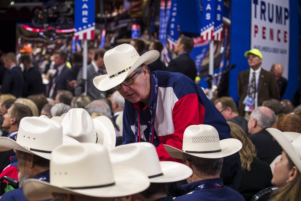 Texas Lt. Gov. Dan Patrick huddles with fellow state delegates during an effort by anti-Trump delegates to force a roll-call vote on convention rules during the opening session of the Republican National Convention on Monday, July 18, 2016, in Cleveland. (Smiley N. Pool/The Dallas Morning News)