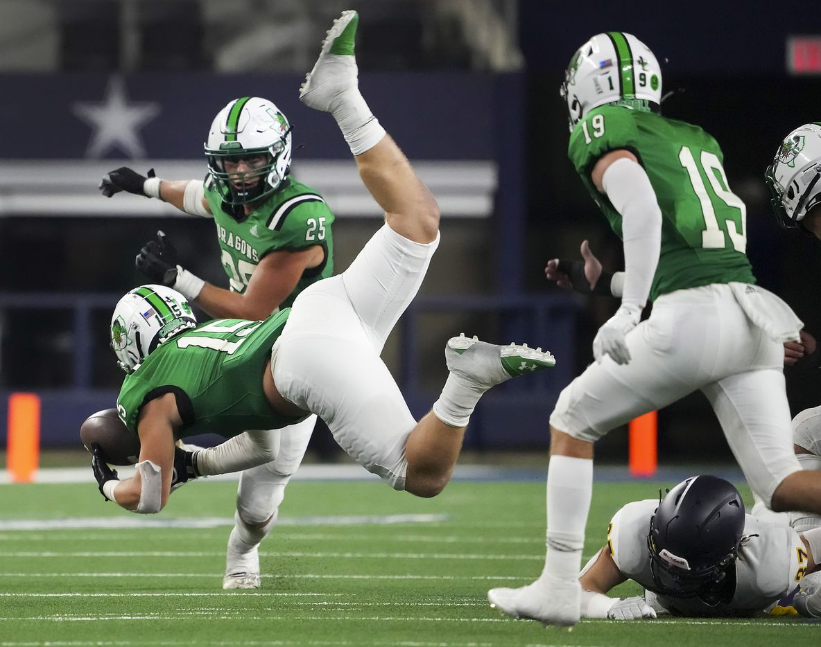 Southlake Carroll linebacker Allan Kleiman (15) makes a leaping interception on a pass intended for Highland Park running back Jay Cox (37) during the second half of a high school football game at AT&T Stadium on Thursday, Aug. 26, 2021, in Arlington.
