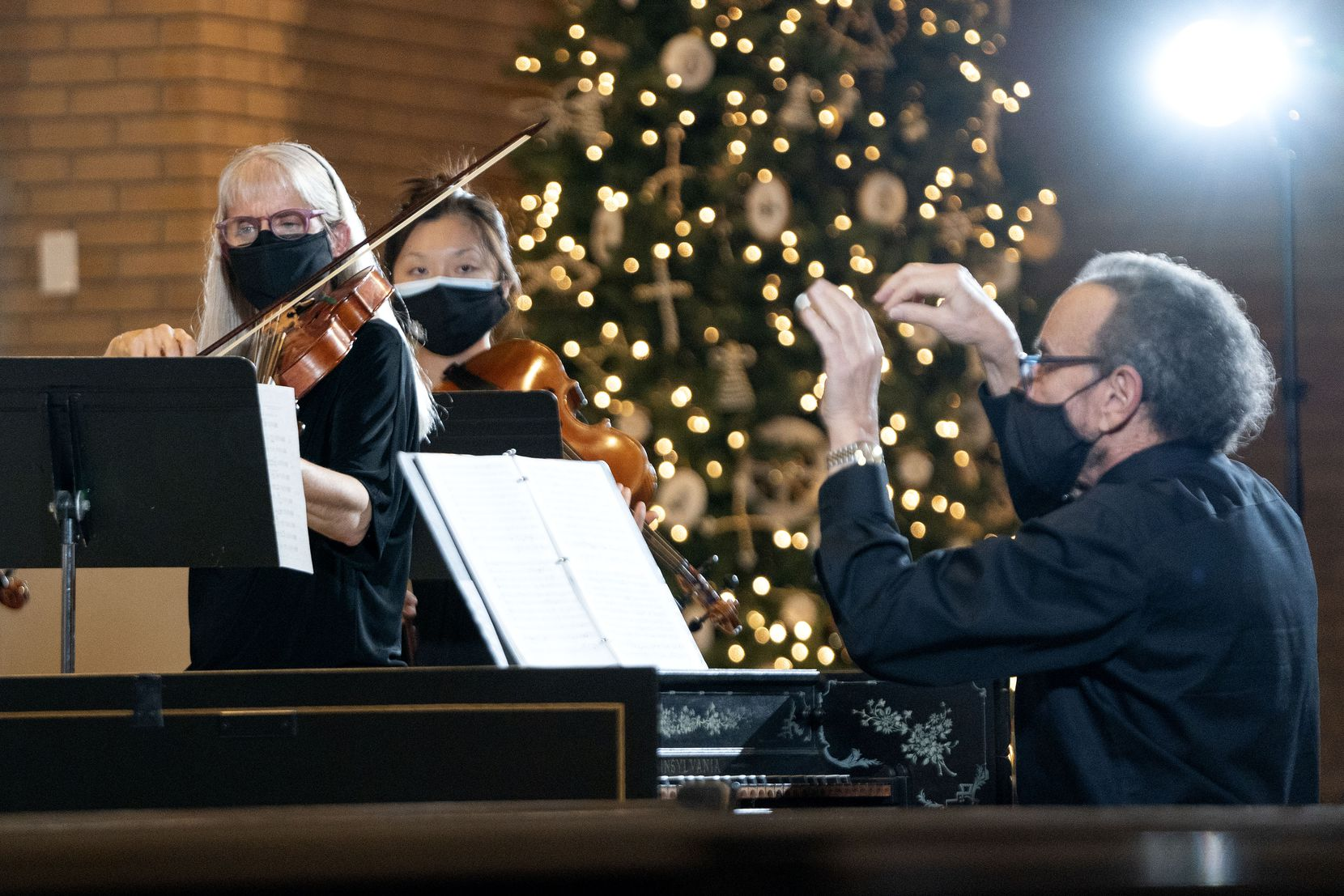 Violinist Clare Adkins Cason (left)  plays as James Richman  conducts during the Dallas Bach Society's Christmas Concertos concert, Saturday, Dec. 5, 2020 at Zion Lutheran Church in Dallas.