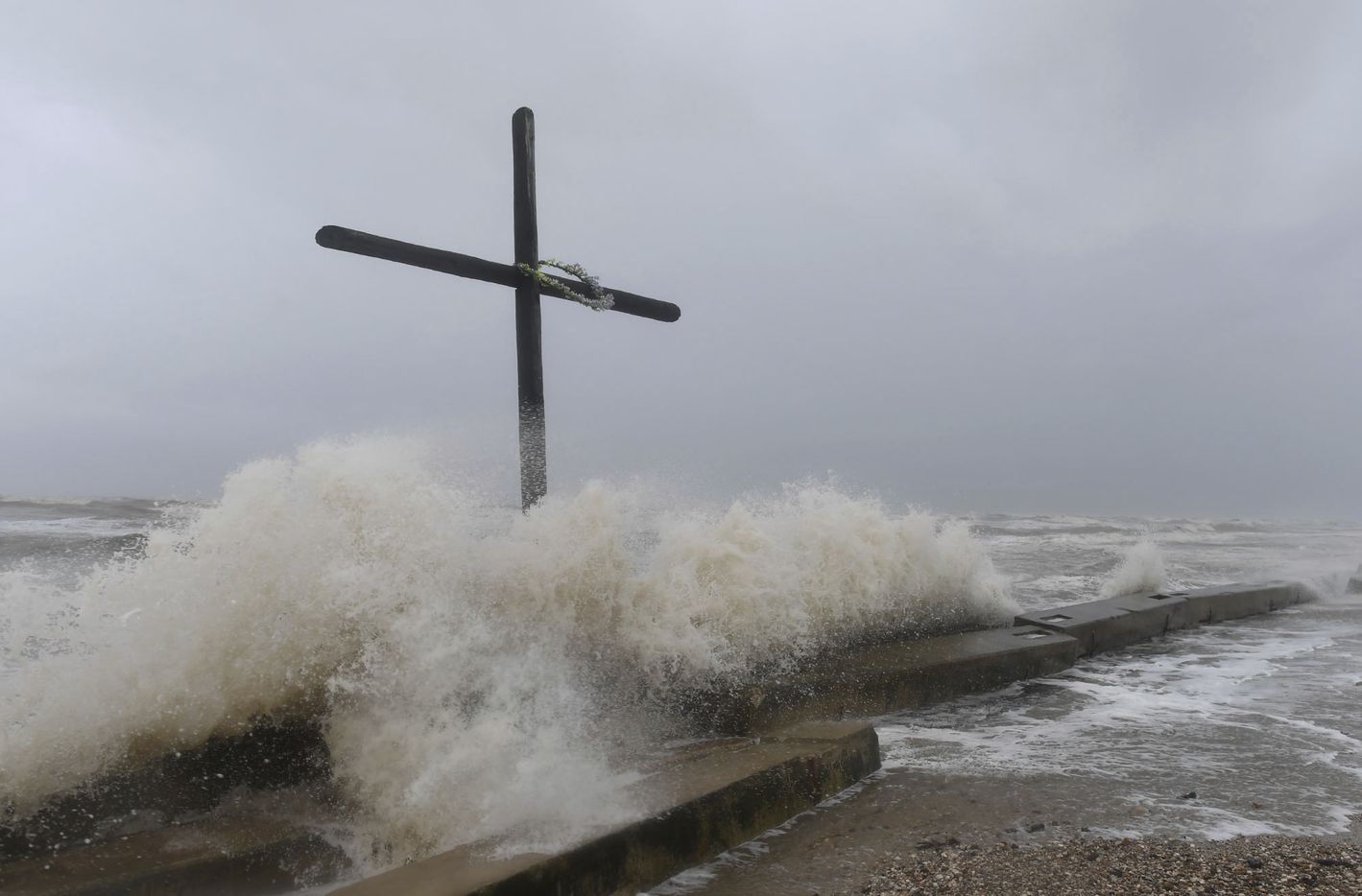 Larger than usual waves crash ashore on Bolivar Peninsula, Friday, Aug. 25, 2017, as Hurricane Harvey approaches Texas.