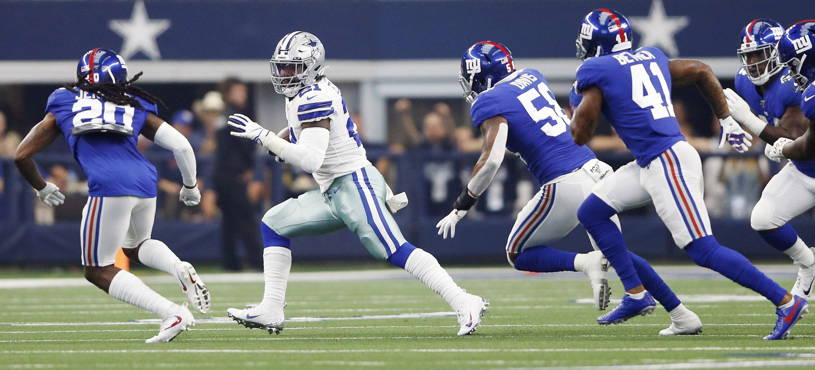 Dallas Cowboys running back Ezekiel Elliott (21) rushes up the field in the home opener between the Dallas Cowboys and New York Giants at AT&T Stadium in Arlington, Texas, on Sunday, September 8, 2019.