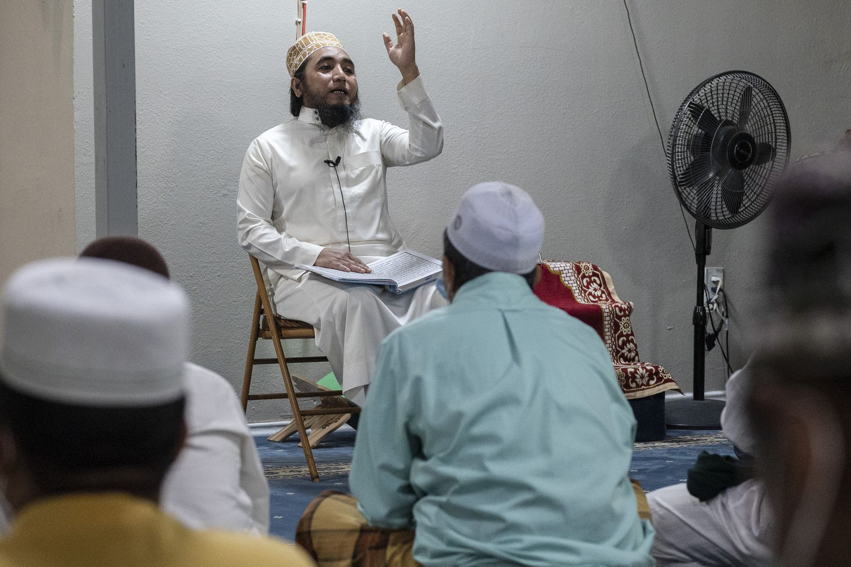 Mohammad Ismail, the imam, or leader of the mosque, spoke before conducting prayer with Rohingya refugees at an apartment complex in Dallas on July 23. The mosque was built inside a former laundry room for residents.