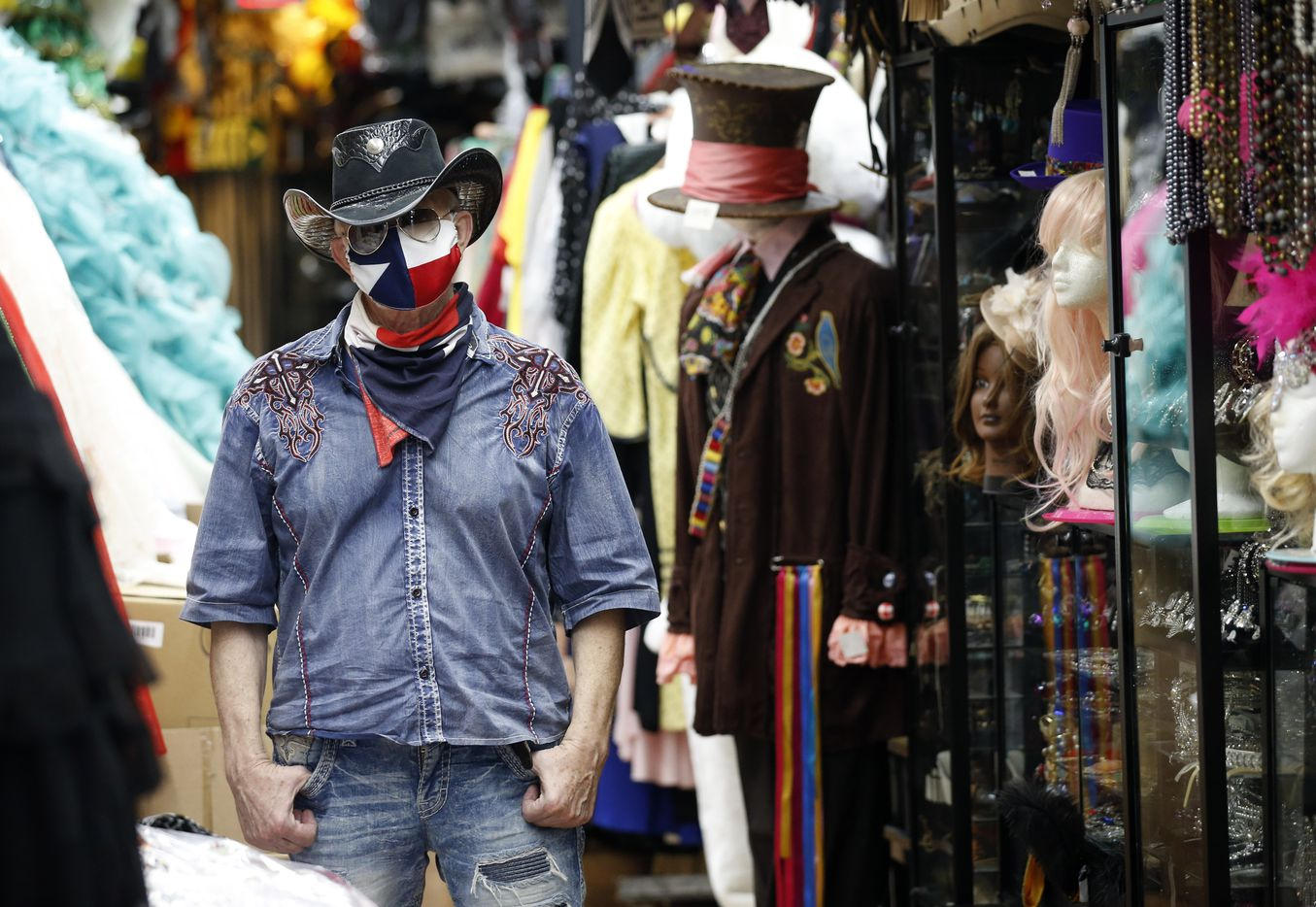 Dallas Vintage shop owner Jerry Purvis poses in one of his shop's face masks.