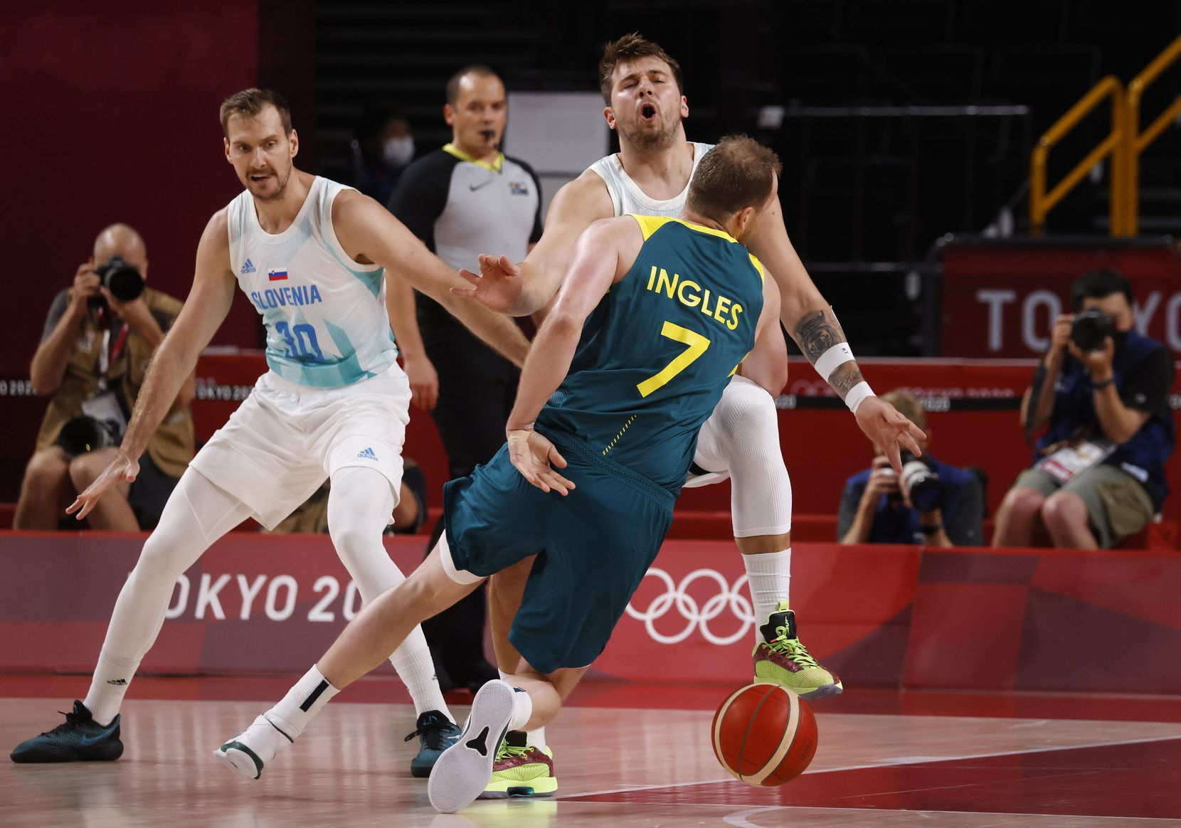 Slovenia's Luka Doncic (77) is fouled by Australia's Joe Ingles (7) during the first quarter of play in the bronze medal basketball game at the postponed 2020 Tokyo Olympics at Saitama Super Arena, on Saturday, August 7, 2021, in Saitama, Japan. (Vernon Bryant/The Dallas Morning News)